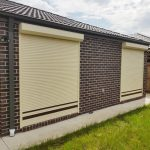 cream white roller shutter with brown stripes