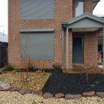 plain grey roller shutter on brick house