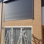 top window dark grey roller shutter