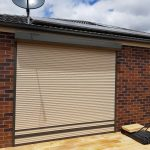 white roller shutter brown stripes and railing