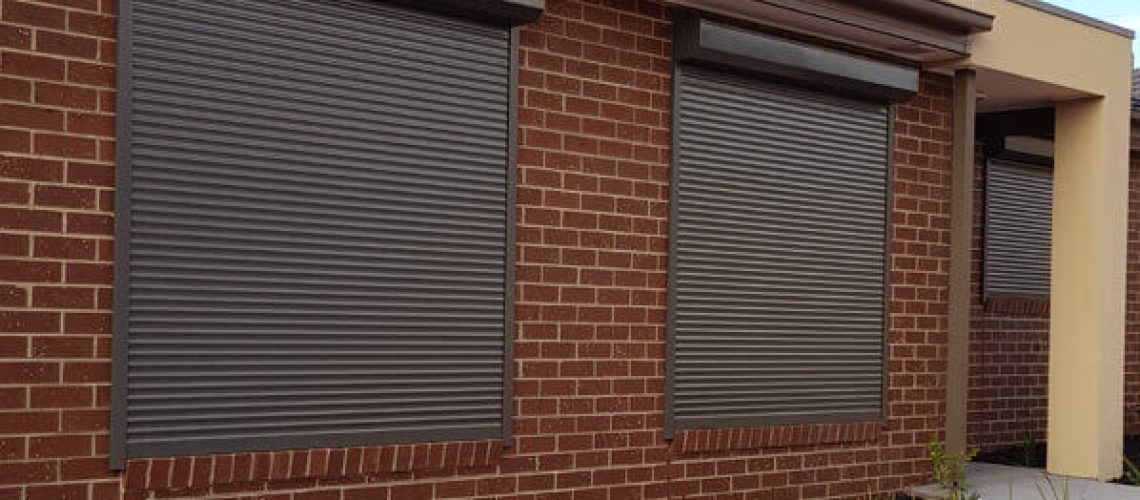 Plain Dark Grey Roller Shutter On Brick House - Price Beat Guarantee Roller Shutters - Quote for Roller Shutters - Roller Shutter Sales and Installations - Window Roller Shutters Melbourne – Melbourne Roller Shutters - Aus Window Roller Shutters